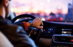 an executive driving a car